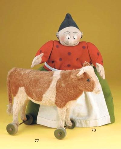 A Steiff cow on wheels