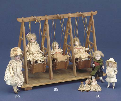 A wood set of doll's fairgroun