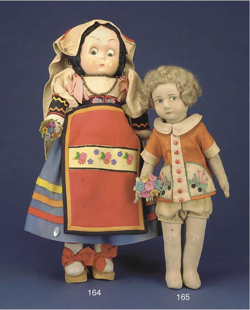 A painted felt Lenci child dol
