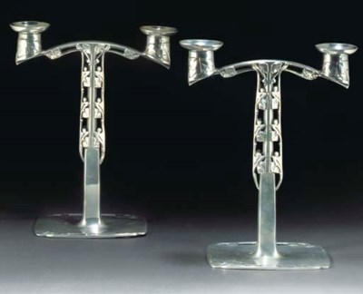 ARCHIBALD KNOX; PAIR OF CANDEL