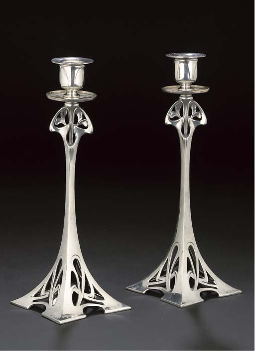 A PAIR OF WMF SILVERED METAL C