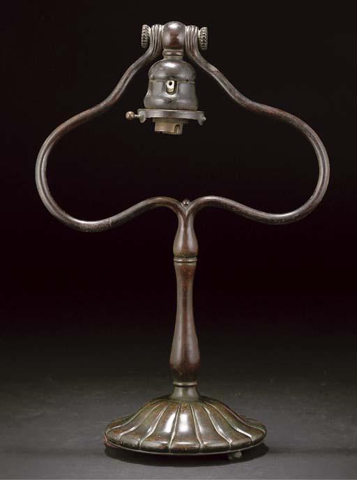 A TIFFANY STUDIOS PATINATED BRONZE TABLE LAMP BASE,