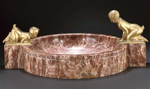 A large gilt bronze and marble