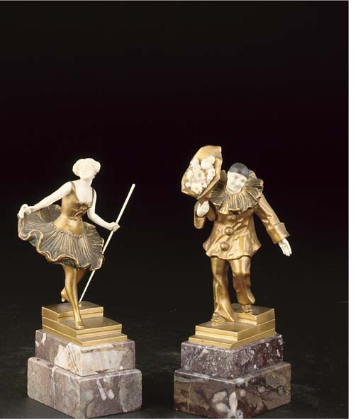A pair of gilt bronze and ivor