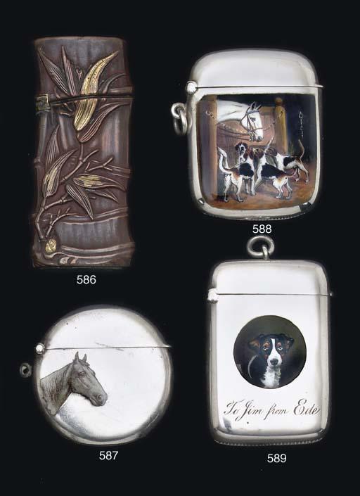A patinated brass vesta case