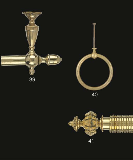 A Victorian brass curtain pole