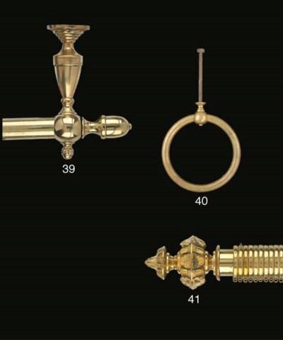 A Victorian brass curtain pole