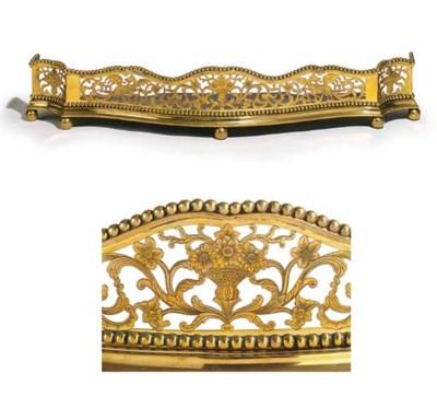 A late Victorian brass fender