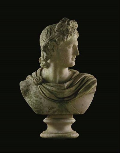 A white marble bust of the Apo