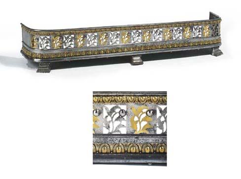 A Regency steel and brass fend