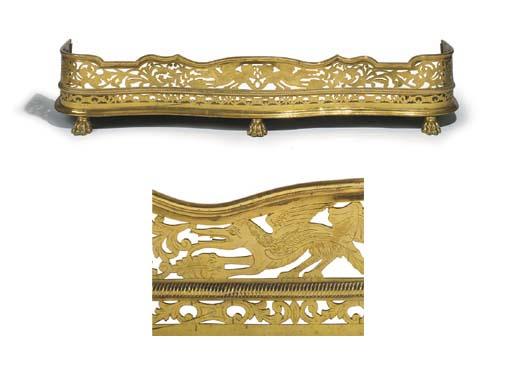 An Edwardian brass fender