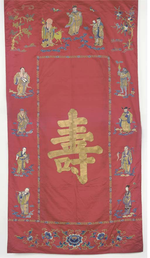 A RED SATIN HANGING EMBROIDERE