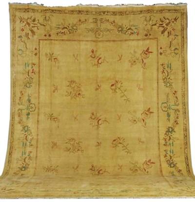 A massive carpet of Aubusson d