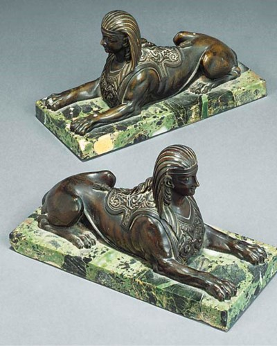 A PAIR OF BRONZE MODELS OF REC