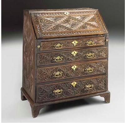 A carved oak bureau