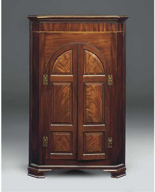 A mahogany and inlaid corner c