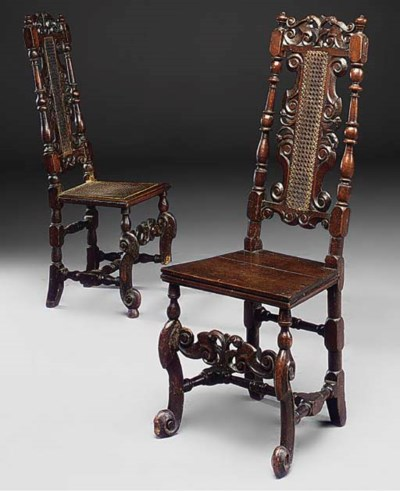 A pair of carved walnut and ca