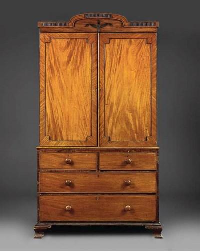 A mahogany and ebonised linen
