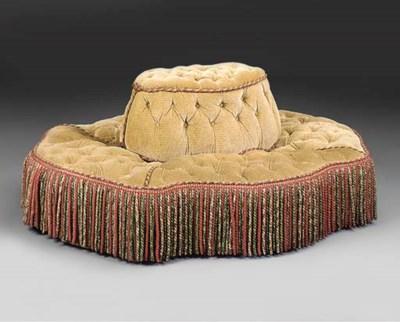 A Victorian conversation sofa