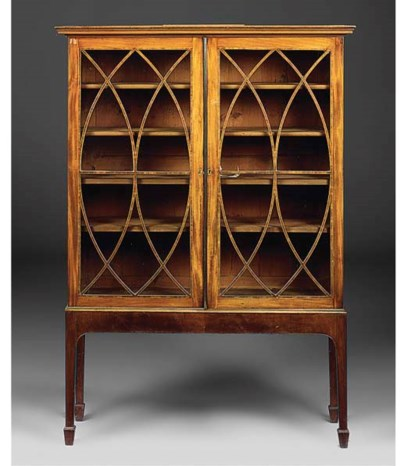 A mahogany and inlaid cabinet