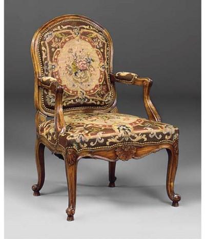 A walnut and needlework uphols