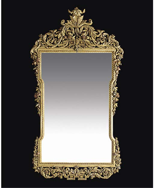 A French gilt and painted mirror