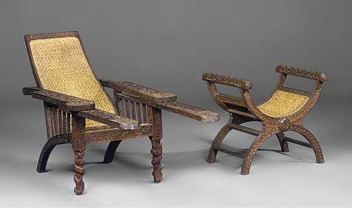 AN ANGLO INDIAN TEAK CARVED PLANTER'S CHAIR
