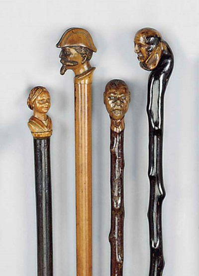 A carved softwood and malacca