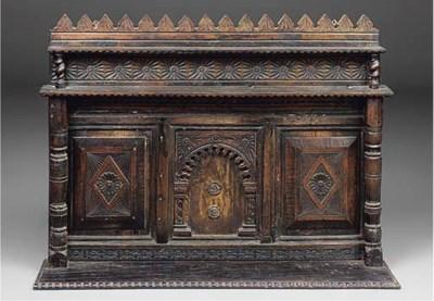 An oak triple panel overmantel