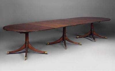A mahogany triple pedestal din