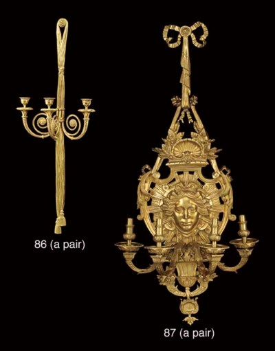 A large pair of gilt bronze fo