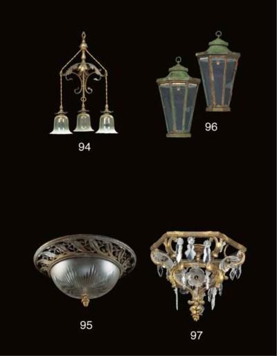A brass three-light chandelier