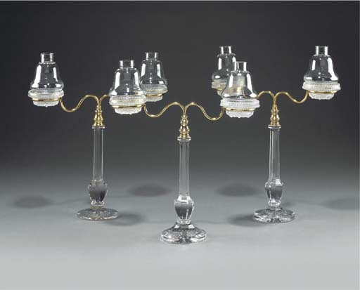 A group of three glass and brass Cricklite patent candle holders