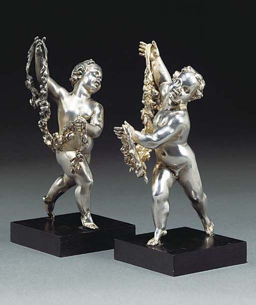 Two English silver figures of youths with garlands