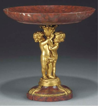 A French gilt bronze and rouge