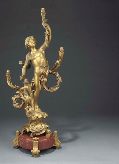A gilt bronze figural five lig