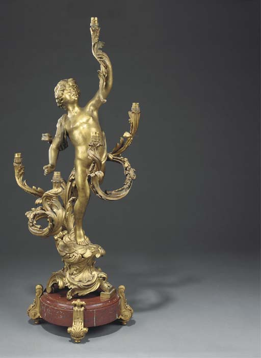 A gilt bronze figural five light candelabrum