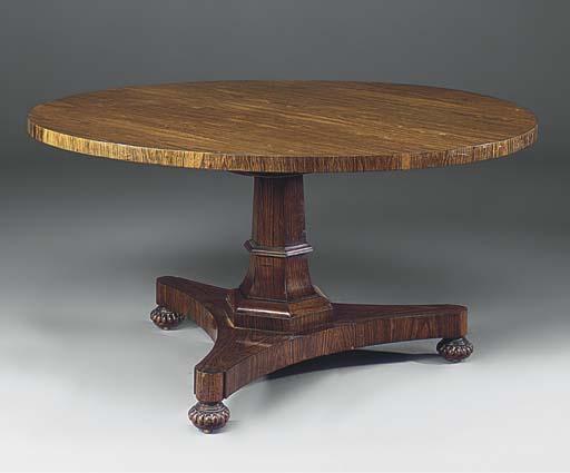 A ROSEWOOD CIRCULAR BREAKFAST TABLE