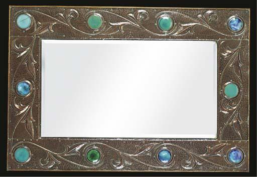 An arts & crafts copper framed mirror