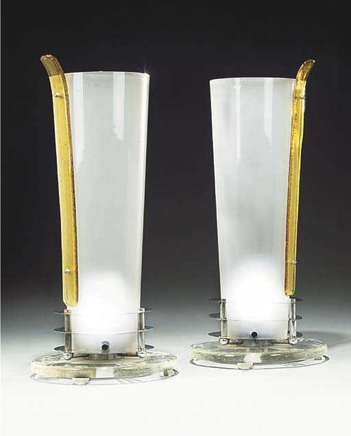 A pair of glass and silvered metal table lamps