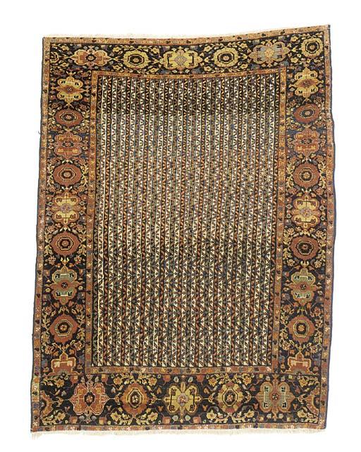 An antique Sarouk rug