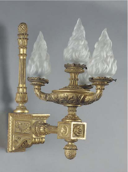 A carved giltwood four light w
