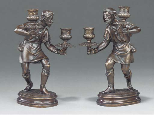 A pair of bronze figural cande