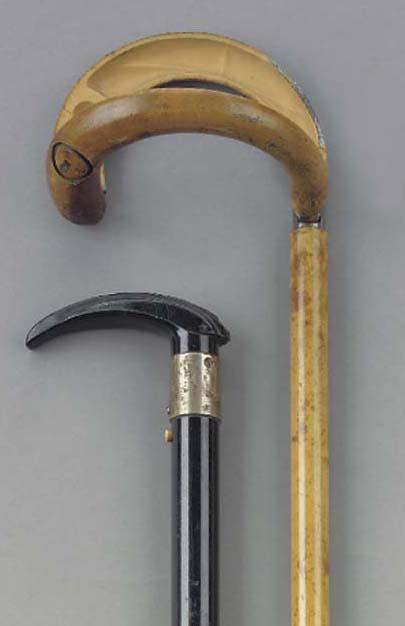 An ebonized 'gadget' torch lig