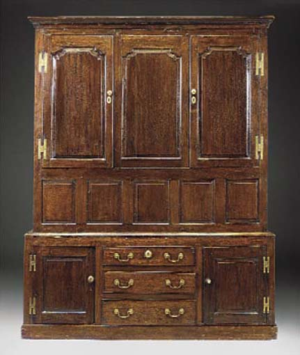AN OAK PRESS CUPBOARD