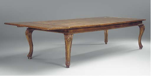 A LARGE WALNUT DINING TABLE