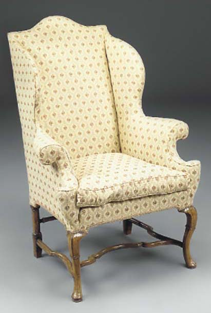 A WALNUT AND WING ARMCHAIR
