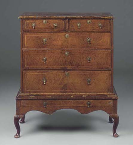 A WALNUT CHEST ON LATER STAND