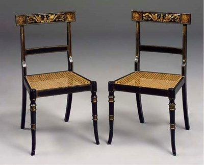 A SET OF SIX EBONISED AND GILT