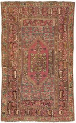 An antique Ghiordes rug